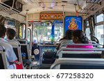 Small photo of SRI LANKA, MARCH 14, 2016 express bus is equipped with extra ornamentation, sound and TV system. Buses are a popular means of communication between villages and cities.