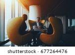 business conversation between... | Shutterstock . vector #677264476