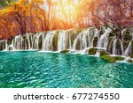 autumn view of the waterfall... | Shutterstock . vector #677274550