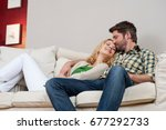 wife and husband on couch | Shutterstock . vector #677292733