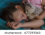 little blond child sleeping in... | Shutterstock . vector #677293363