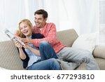 couple fighting for newspaper | Shutterstock . vector #677293810
