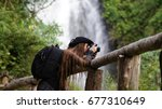 female tourist with backpack... | Shutterstock . vector #677310649