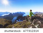 woman hiker relaxing at the top ... | Shutterstock . vector #677312314
