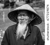 old vietnamese man with a... | Shutterstock . vector #677319874
