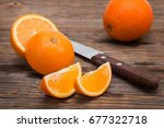 juicy oranges on a wooden... | Shutterstock . vector #677322718