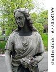 sad statue of woman  where... | Shutterstock . vector #677358199