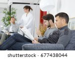 different people sitting in a... | Shutterstock . vector #677438044