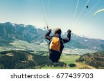 paraglider is on the paraplane... | Shutterstock . vector #677439703
