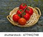bunch of fresh tomatoes and... | Shutterstock . vector #677442748