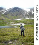 Small photo of Man in Alaskan back-country