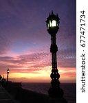 streetlamp at sunset in cadiz | Shutterstock . vector #677471734