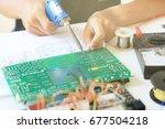 empty hands testing electronic... | Shutterstock . vector #677504218