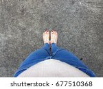 close up of bare feet with red... | Shutterstock . vector #677510368