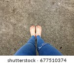 close up of bare feet with red... | Shutterstock . vector #677510374