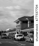 Small photo of Feltham, London, Middlesex, England - July 14, 2017: Monochrome Tesco Extra supermarket store, company founded by Jack Cohen in 1919