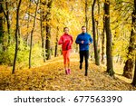 young couple jogging together... | Shutterstock . vector #677563390