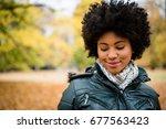 teenage girl outdoors in autumn ... | Shutterstock . vector #677563423