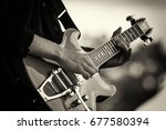 close up of man playing a rock... | Shutterstock . vector #677580394