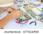 empty hands testing electronic... | Shutterstock . vector #677616904
