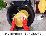 hands in red rubber gloves... | Shutterstock . vector #677623048