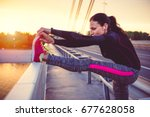fitness woman doing stretching... | Shutterstock . vector #677628058