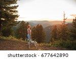 Stock photo tourist and dalmatian walk in the mountains 677642890
