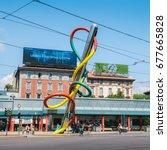 Small photo of Milan, Italy - July 14th, 2017: Italy, Lombardy, Milan, Piazzale Luigi Cadorna, work of Claes Oldenburg and Coosje van Bruggen called Ago, Filo e Nodo (2000)