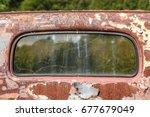 Rear Window In Rusted Truck