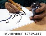 man hands writing arabic...   Shutterstock . vector #677691853