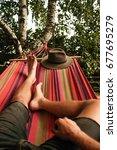 man woman lying in the hammock... | Shutterstock . vector #677695279