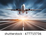 Small photo of Airplane and road with motion blur effect at sunset. Landscape with passenger airplane is flying over the asphalt road and cloudy sky. Commercial plane is landing. Aircraft with blurred background