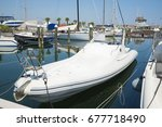 white yachts in the port... | Shutterstock . vector #677718490