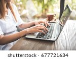 young woman keyboarding on... | Shutterstock . vector #677721634