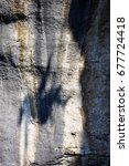 shadow of a climber at high... | Shutterstock . vector #677724418