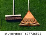 brush and broom on a green... | Shutterstock . vector #677726533