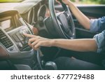 asian women press button on car ... | Shutterstock . vector #677729488