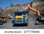 open pit coal mine. loading... | Shutterstock . vector #677778580