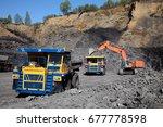open pit coal mine. loading... | Shutterstock . vector #677778598