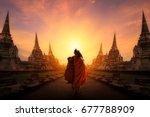 monk walking at ayutthaya... | Shutterstock . vector #677788909