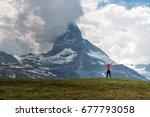 the matterhorn and the girl ... | Shutterstock . vector #677793058