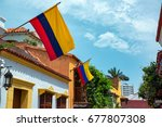 colombian flags on a row of... | Shutterstock . vector #677807308