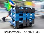 delivery water with dolly by... | Shutterstock . vector #677824138