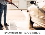 male worker wash the car with... | Shutterstock . vector #677848873