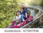 smiling women and her boy... | Shutterstock . vector #677857948