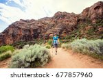 happy senior woman hiking in a... | Shutterstock . vector #677857960