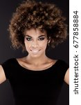 Small photo of Beauty portrait of smiling african american woman with afro hairstyle.