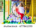 little girl on the playground... | Shutterstock . vector #677861350