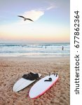 surfboards lay on the sand at... | Shutterstock . vector #677862364