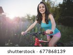 young woman on a bicycle. | Shutterstock . vector #677868139